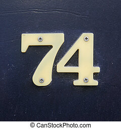 Number 74 - plastic house number seventy four