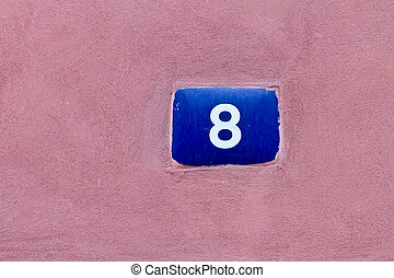 Number 8 on old pink wall, background