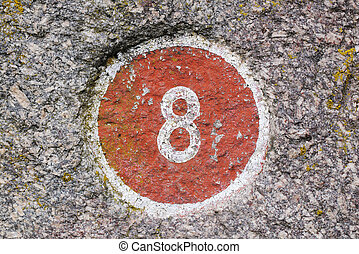 Number 8 painted inside a red circle