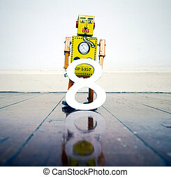 number 8 robot toy on a wooden floor with reflection yellow