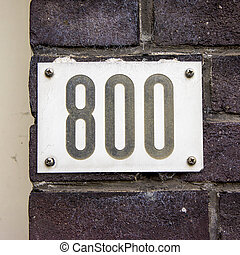 Number 800 - house number eight hundred. Black numerals on a...