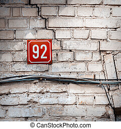 Number 92 on a wall - Number 92 on textured brick wall