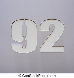 Number 92 - house number ninety two cut out in a metal plate