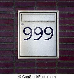 Number 999 - house number nine hundred and ninety nine on a...