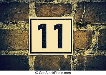 Number eleven, detail of odd number in a house, postal ...