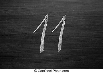 number eleven enumeration written with a chalk on the blackboard