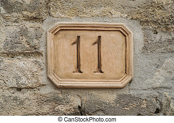 number eleven on a wall