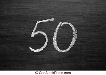 number fifty enumeration written with a chalk on the blackboard
