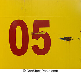 number five 5 on rusted yellow metal plate