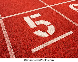 Number five. Big white track number on red rubber racetrack