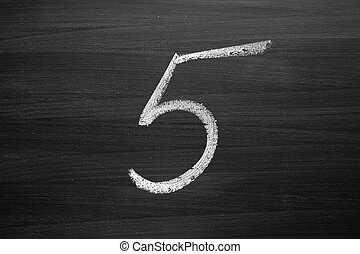 number five enumeration written with a chalk on the blackboard