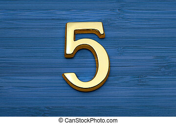 number five, house address plate number on blue wooden backgroun