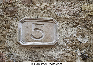 number five on a wall