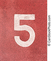 Number five,White track number on rubber racetrack, texture of running racetracks in small stadium.