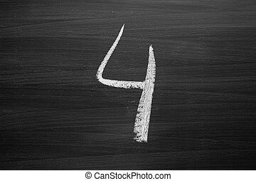 number four enumeration written with a chalk on the blackboard