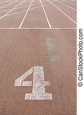 Number four on a running track