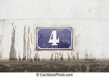 Number four on the wall of a house