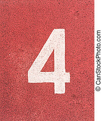 Number four,White track number on rubber racetrack, texture of running racetracks in small stadium.