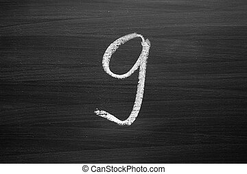 number nine enumeration written with a chalk on the blackboard