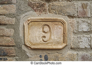 number nine on a wall