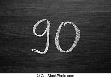 number ninety enumeration written with a chalk on the blackboard