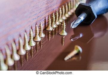 number of screws on the wooden background