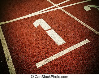 Number one. White track number on red rubber racetrack