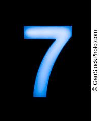 Number seven 7 sign in blue led light on a black background...