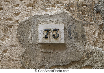 number seventy three on a wall