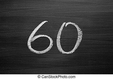 number sixty enumeration written with a chalk on the blackboard