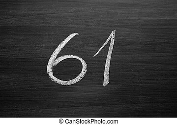 number sixty one enumeration written with a chalk on the blackboard