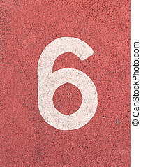 Number six,White track number on rubber racetrack, texture of running racetracks in small stadium.
