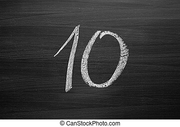 number ten enumeration written with a chalk on the blackboard