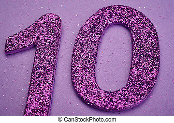 Number ten purple color over a purple background. Anniversary
