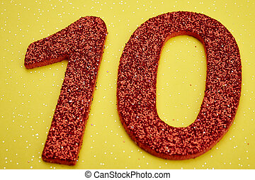 Number ten red color over a yellow background. Anniversary