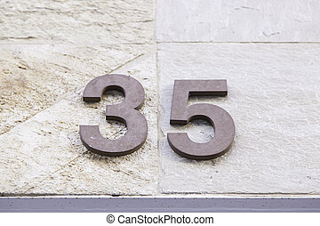 Number thirty-five in a wall