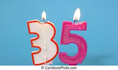 Number thirty five shaped burning candles