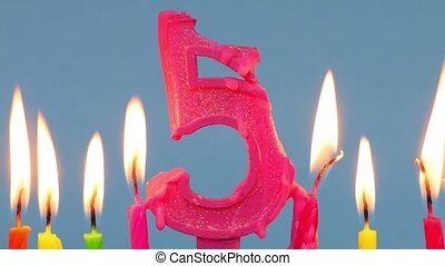 Number thirty five shaped burning candles.Time lapse
