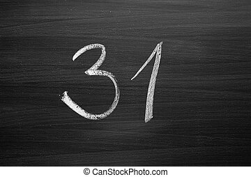 number thirty one enumeration written with a chalk on the blackboard