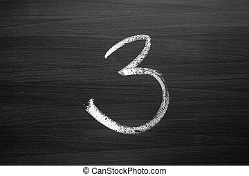 number three enumeration written with a chalk on the blackboard