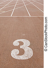 Number three on a running track