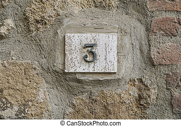number three on a wall