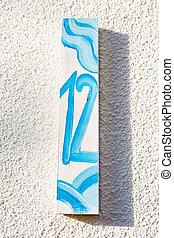 Number twelve 12 painted on wooden signboard