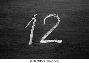 number twelve enumeration written with a chalk on the blackboard