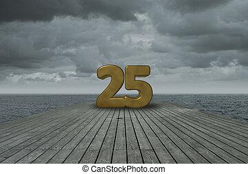 number twenty five on wooden floor at ocean