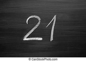 number twenty one enumeration written with a chalk on the blackboard