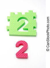 Number two puzzle mats. Focus on the front (small DOF)