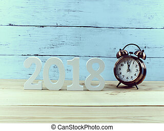 number wooden material happy new year on wooden background with copy space