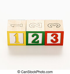 Numbered toy blocks. - Numbered toy in a line.