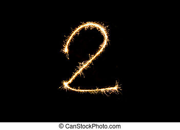 Numbers 2 or two Sparkler firework light isolated on black background